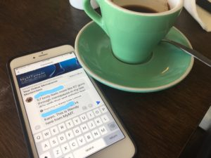 close up of coffee and iphone with messages from MyMT